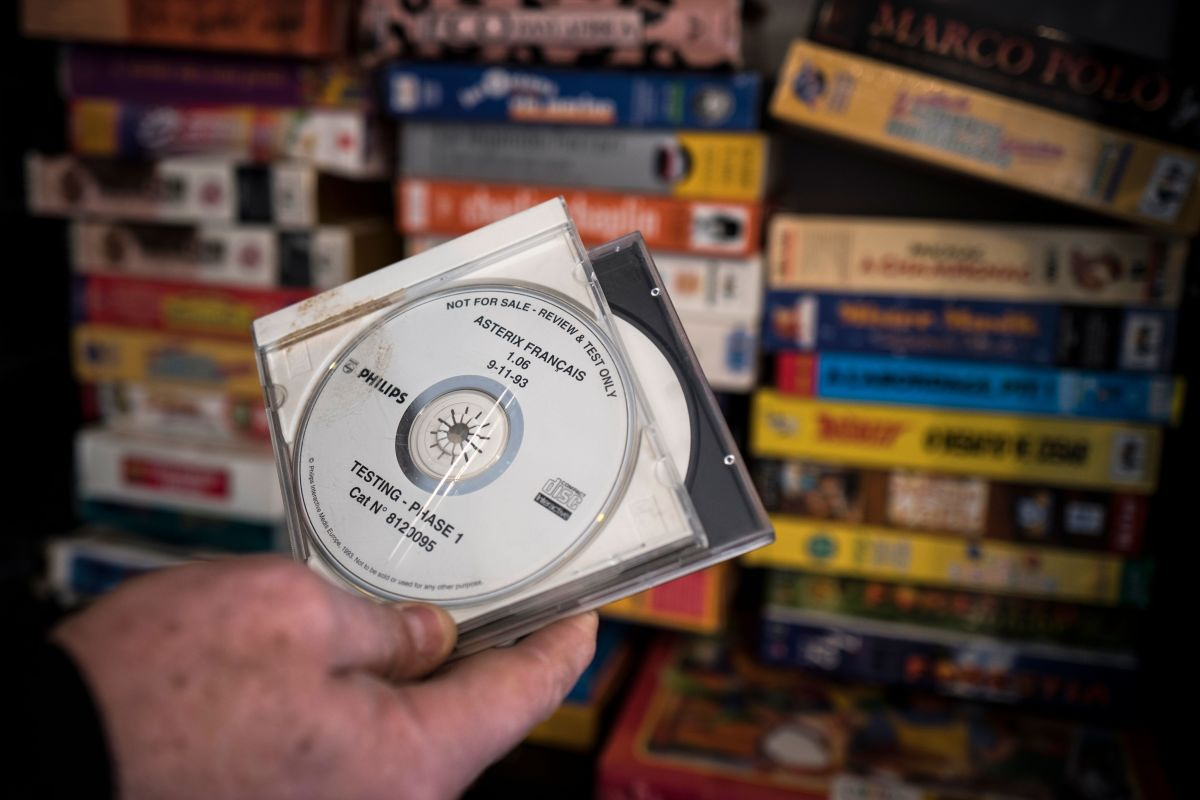 French video game pioneer Bertrand Brocard presents a video game compact disc, part of the collection of the French National Conservatory of Video Games, on February 20th, 2018. Brocard created the French National Conservatory of Video Games in 2016 to preserve items from the industry that have survived from the 1980s.