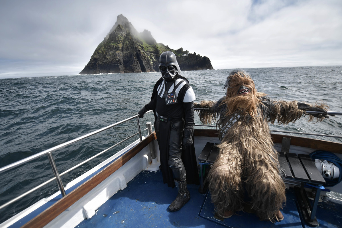 Fans dressed as Darth Vader and Chewbacca take a boat trip to the Skelligs on May 4th, 2018, in Portmagee, Ireland. The first-ever Star Wars festival is taking place against the backdrop of the famous Skellig Michael island, which was used extensively in Episode VII and Episode VIII of the popular science-fiction saga. The small fishing village of Portmagee, which is closest to the location, has seen a boom in tourism following the latest films. The village will host a Star Wars drive-in and a Star Wars-themed Irish dancing competition over the weekend.