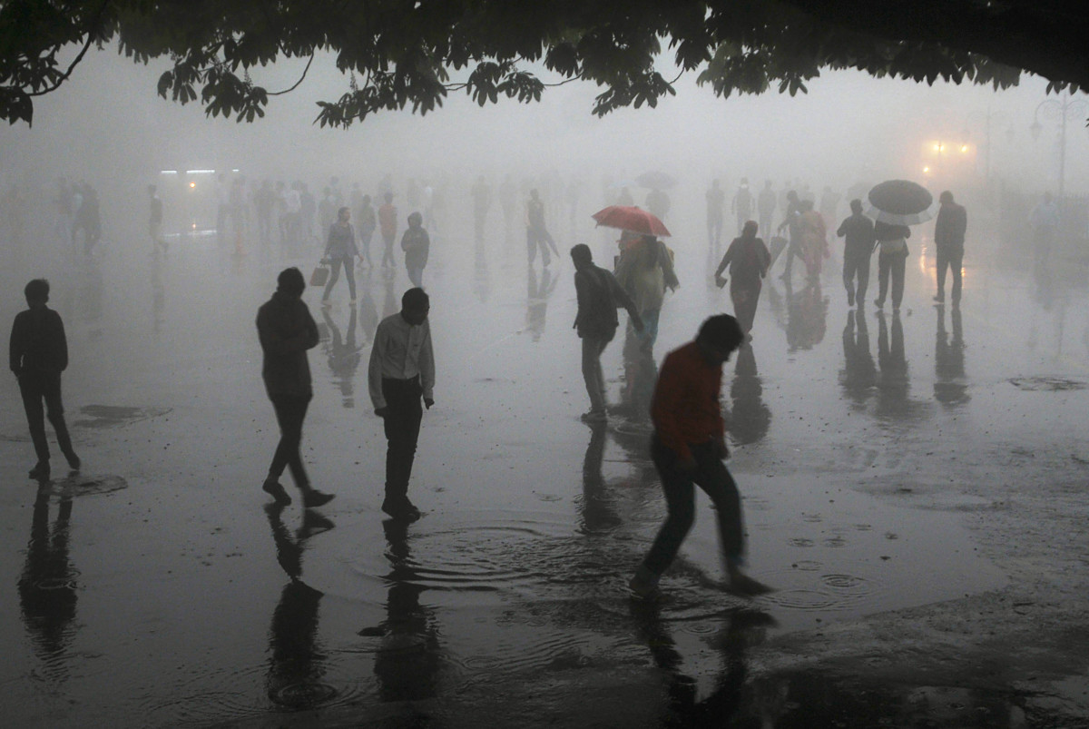People walk under heavy rainfall in the northern hill town of Shimla in Himachal Pradesh state on May 2nd, 2018.