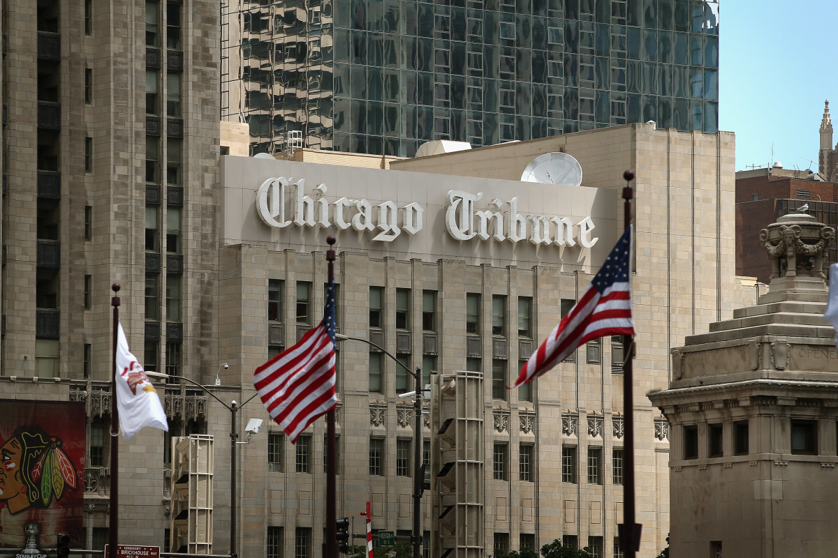 Flags fly along the Michigan Avenue bridge near the Tribune Tower, home of the Chicago Tribune, WGN Radio and the Tribune Company, on July 10th, 2013 in Chicago, Illinois.