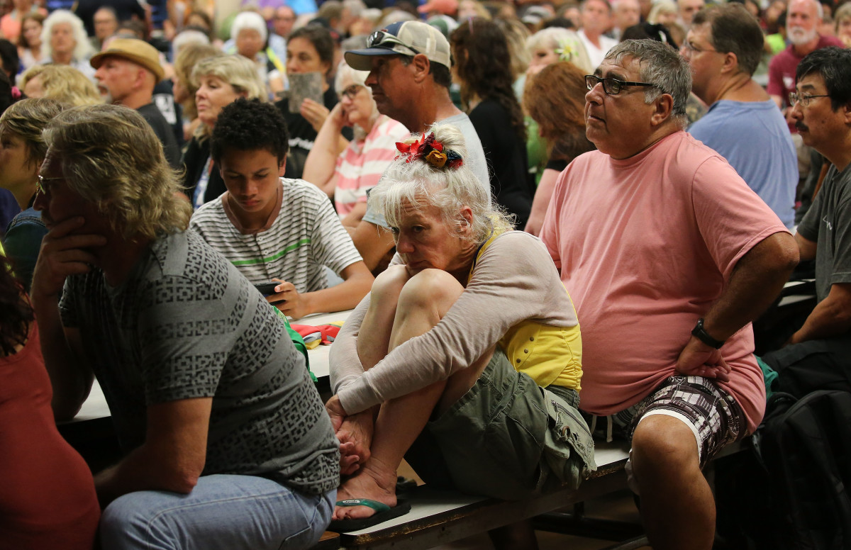 Concerned residents attend a community meeting in the aftermath of eruptions from the Kilauea volcano on Hawaii's Big Island on May 7th, 2018, in Pahoa, Hawaii.