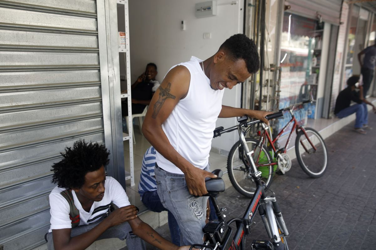 African migrants are seen in Neve Sha'anan, in South Tel Aviv, on September 4th, 2017.