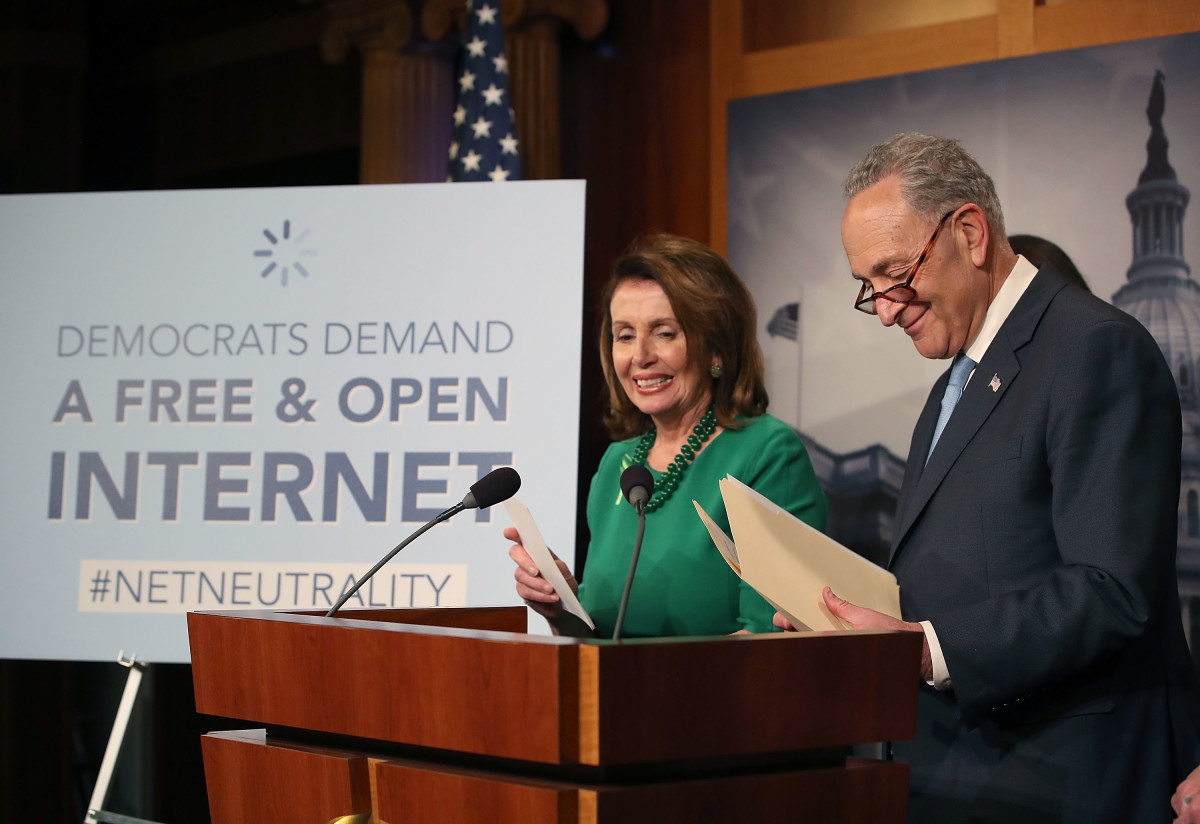 Senate Majority Leader Charles Schumer speaks at a press conference on May 16th, 2018, in Washington, D.C., as House Minority Leader Nancy Pelosi looks on.