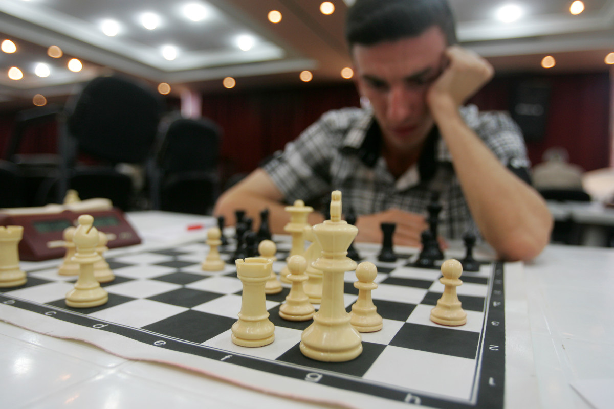 A man plays chess in Baghdad, Iraq.