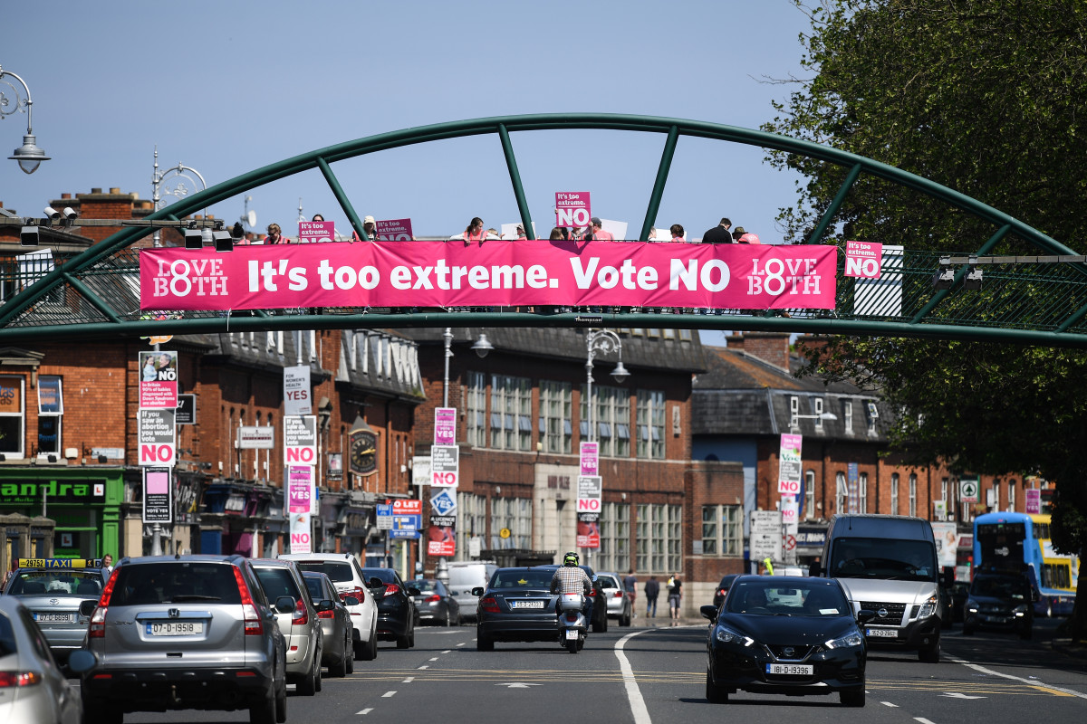 "Members of the public hold ""no"" placards on Fairview road as the country heads to polling stations on May 25th, 2018, in Dublin, Ireland."
