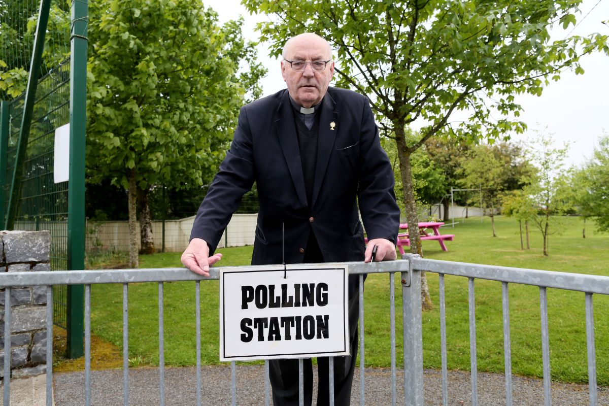 Father Tom Harrington poses for a photograph as he leaves a polling station after voting in the Irish abortion referendum, in Knock, northwest Ireland, on May 25th, 2018.