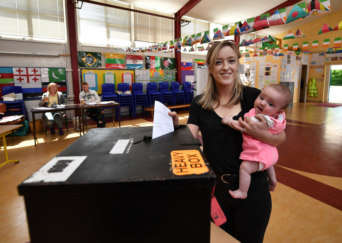 Niamh Gavin casts her vote as she holds her daughter Fiadh, aged five months, at a polling station on May 25th, 2018, in Athlone, Ireland.