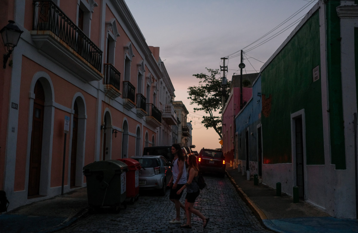 Tourists walk in Old San Juan, Puerto Rico, on April 18th, 2018.