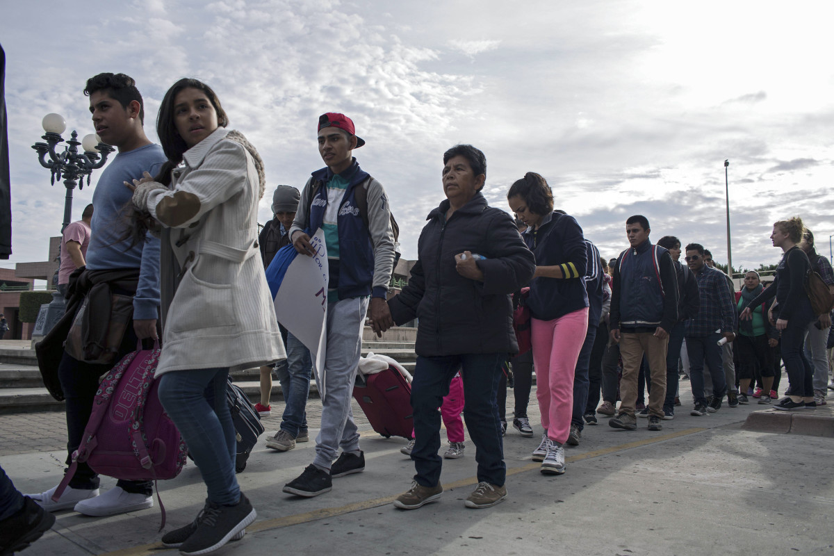 Central American migrants seeking asylum in the United States walk to the U.S.-Mexico border at El Chaparral port of entry on November 12th, 2017, in Tijuana, northwestern Mexico.