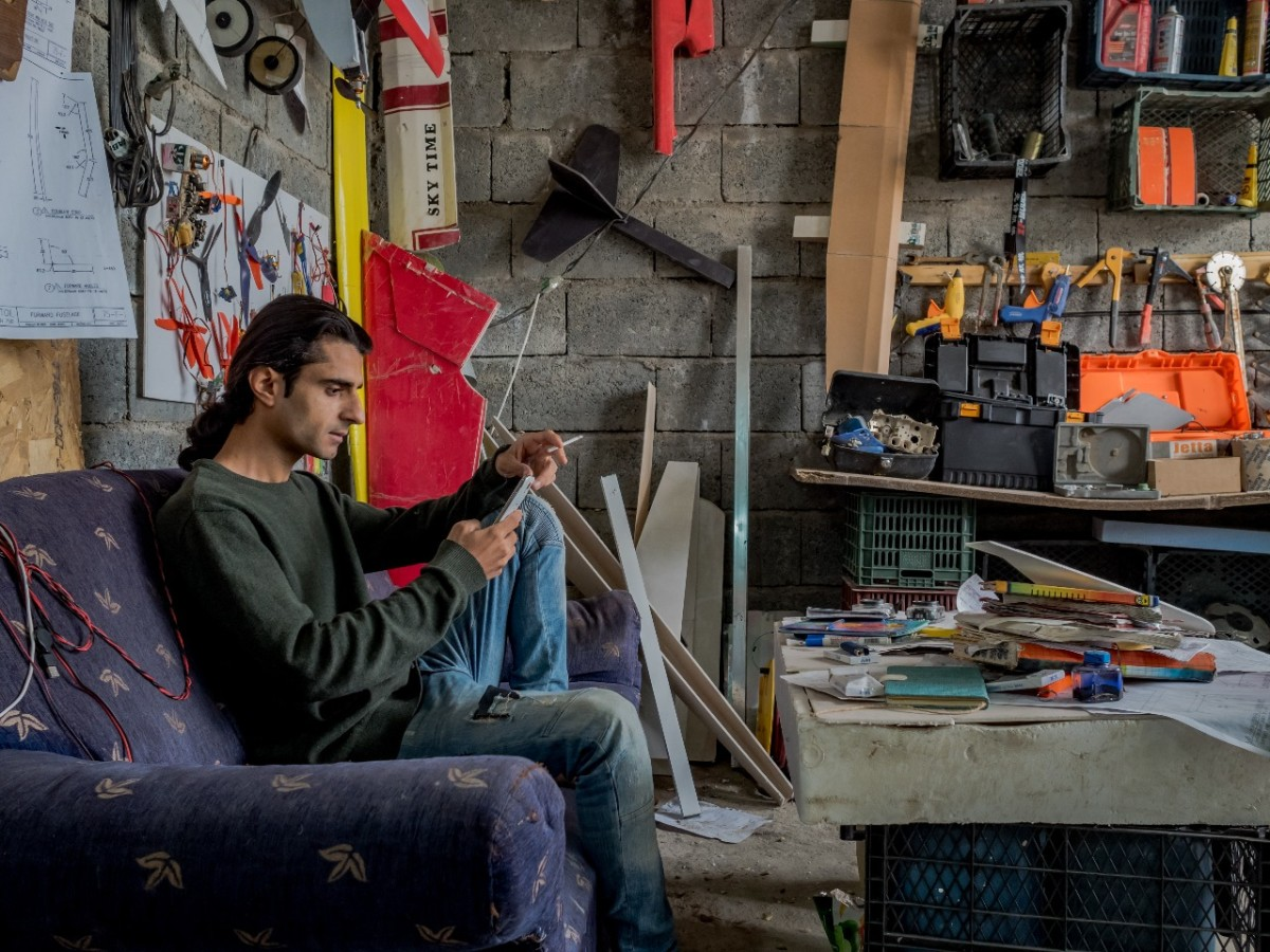 Ari Kamil sits inside his third-floor workshop in Sulaymaniyah, Iraq.