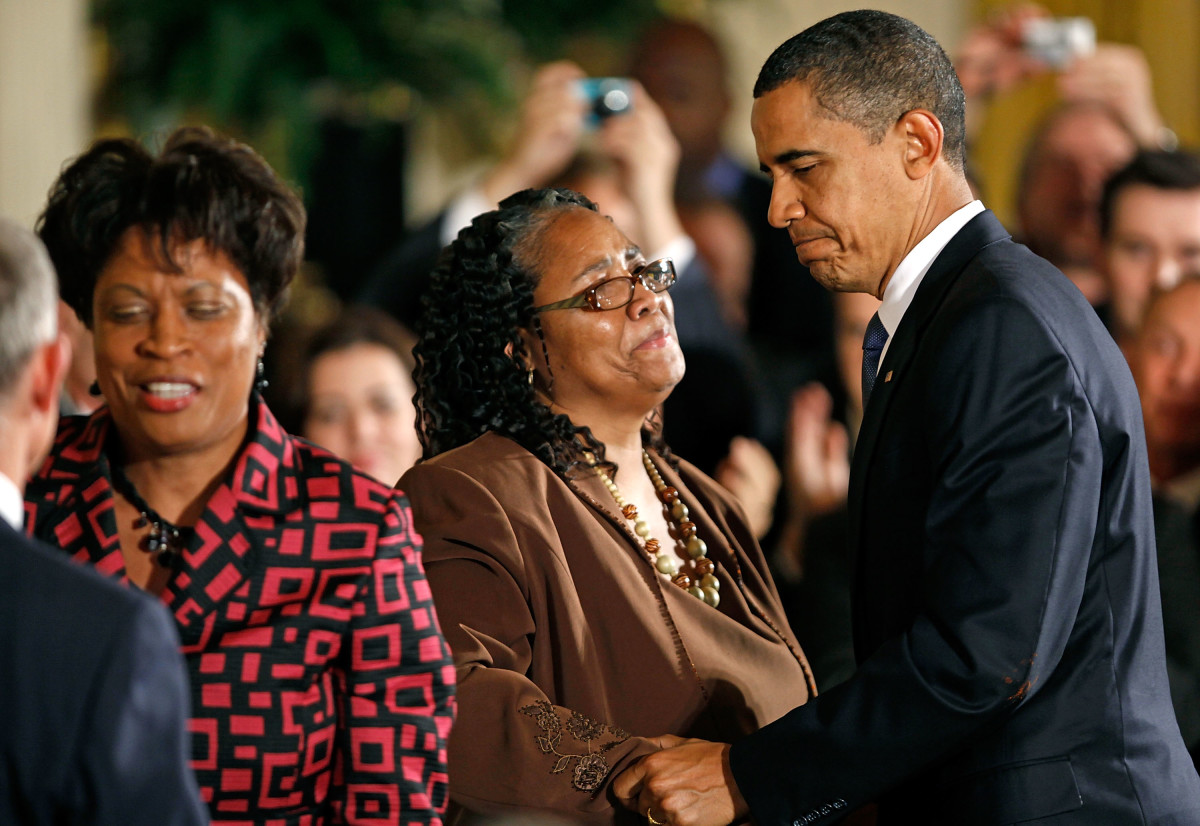 President Barack Obama greets Betty Byrd Boatner (right) and Louvon Harris, sisters of James Byrd Jr., following the enactment of the Matthew Shepard and James Byrd, Jr. Hate Crimes Prevention Act, on October 28th, 2009.