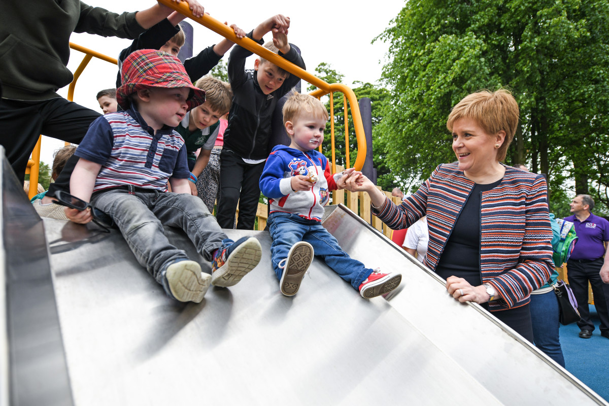 First Minister Nicola Sturgeon holds the hand of two-year-old Jamie McGuiness as she officially opens Play as One Scotland's fully inclusive play park on June 4th, 2018, in Dunfermline, Scotland. The play park has been specially designed for both non-disabled children and children with physical and learning difficulties and is the largest of its kind in Scotland.