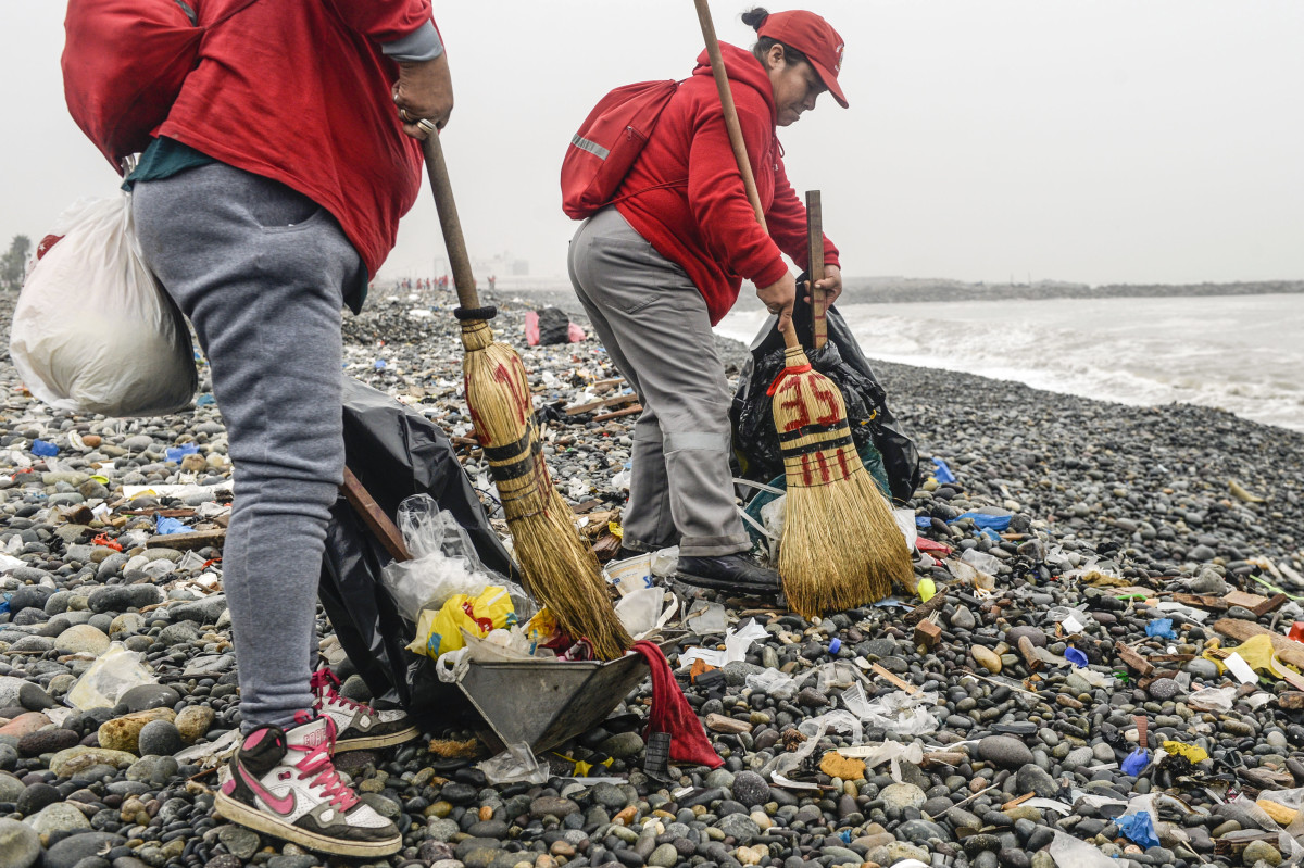 Groups of volunteers clean up plastic waste on a beach in Lima, Peru, during World Environment Day on June 5th, 2018. The United Nations urged people to take steps against the use of plastic bags, as part of a global challenge to reduce the increasing pollution of the oceans.