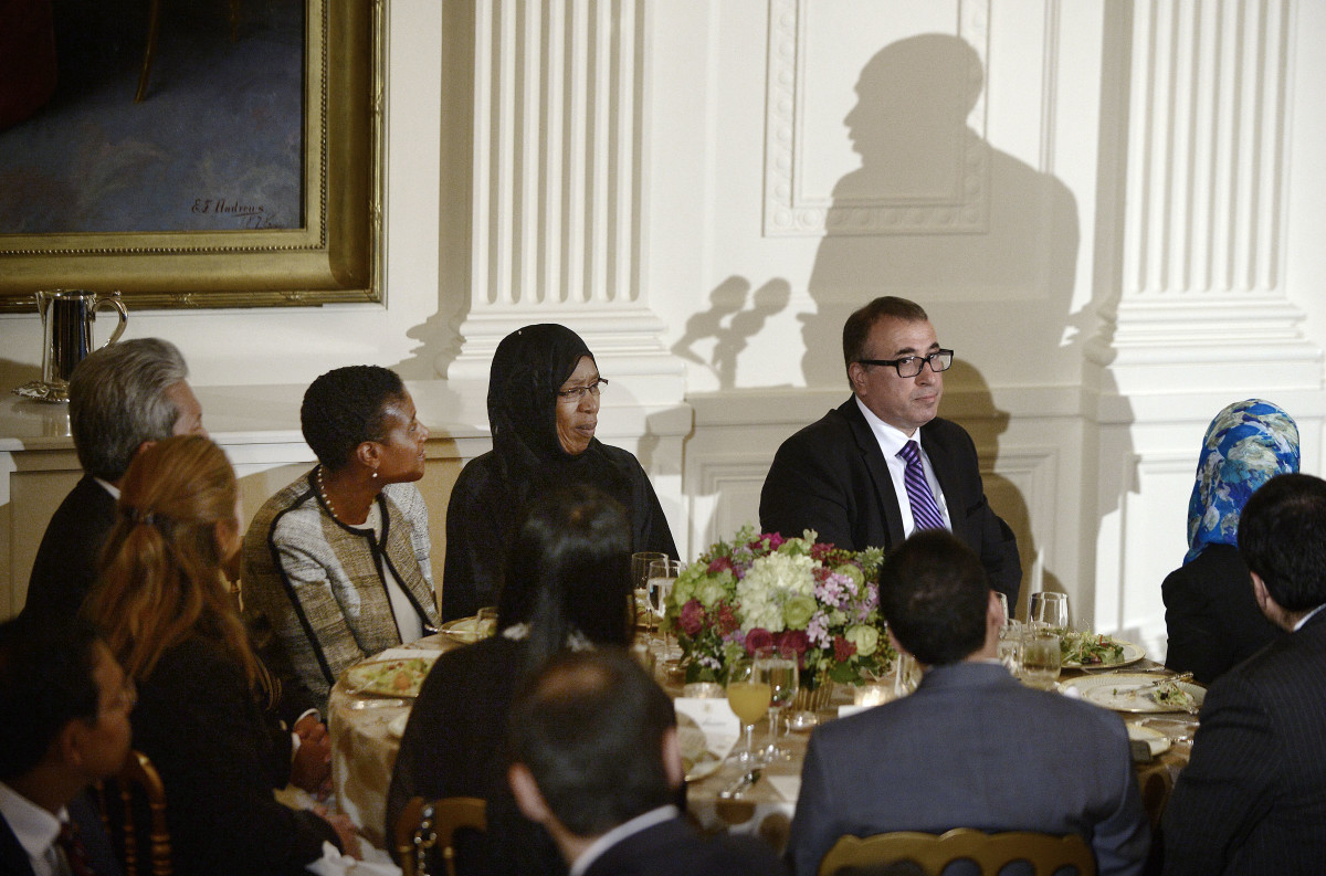 Guests at the 2015 Ramadan dinner listen as President Barack Obama speaks in the East Room of the White House in Washington, D.C.