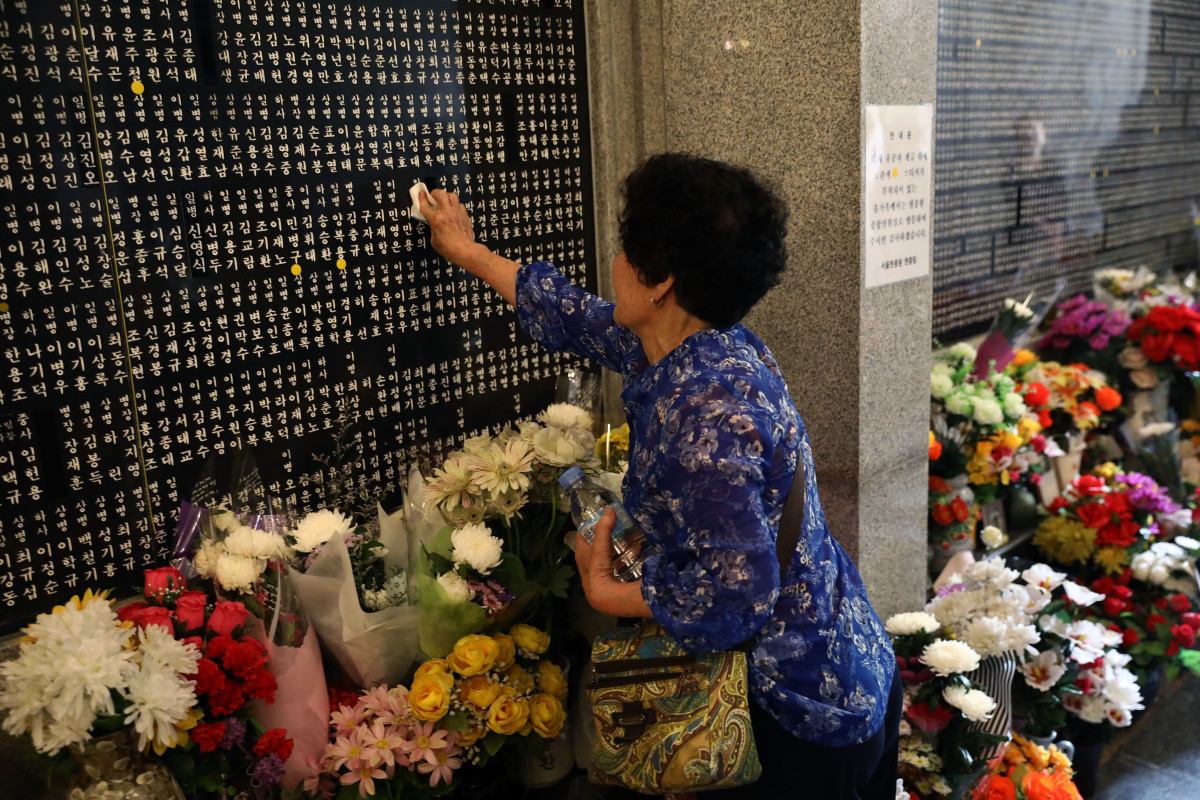 A South Korean woman touches the engraved name of her older brother who died during the Korean War at Seoul National Cemetery on June 6th, 2018, in Seoul, South Korea. South Korean President Moon Jae-in said on Wednesday that his country will push for recovery of remains of the fallen soldiers who died during the 1950-53 Korean War. South Korea marked its 63rd Memorial Day anniversary amid emerging improved relations with the Democratic People's Republic of Korea as the first-ever U.S.-DPRK summit has been scheduled for June 12th in Singapore.