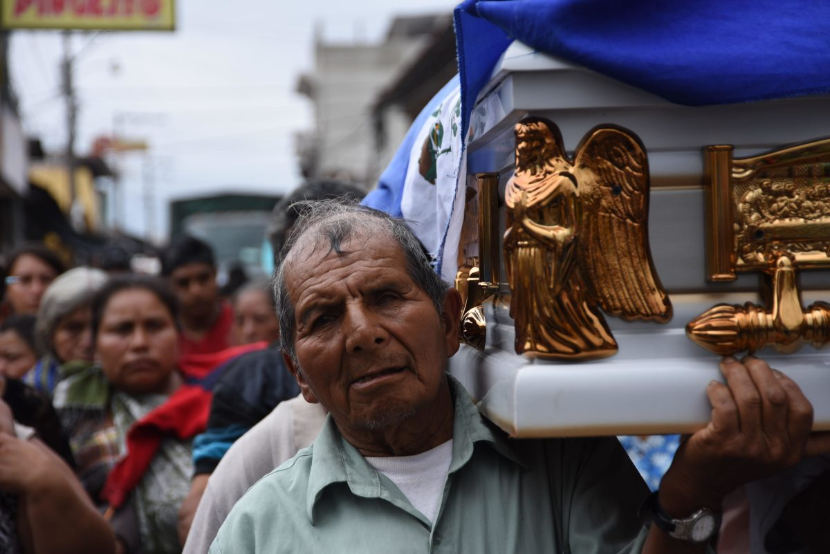 Relatives and residents carry the coffin of 20-year-old Erick Rivas, who died following the eruption of the Fuego volcano, during his funeral in Alotenango municipality, Sacatepequez, about 65 kilometers southwest of Guatemala City, on June 6th, 2018.