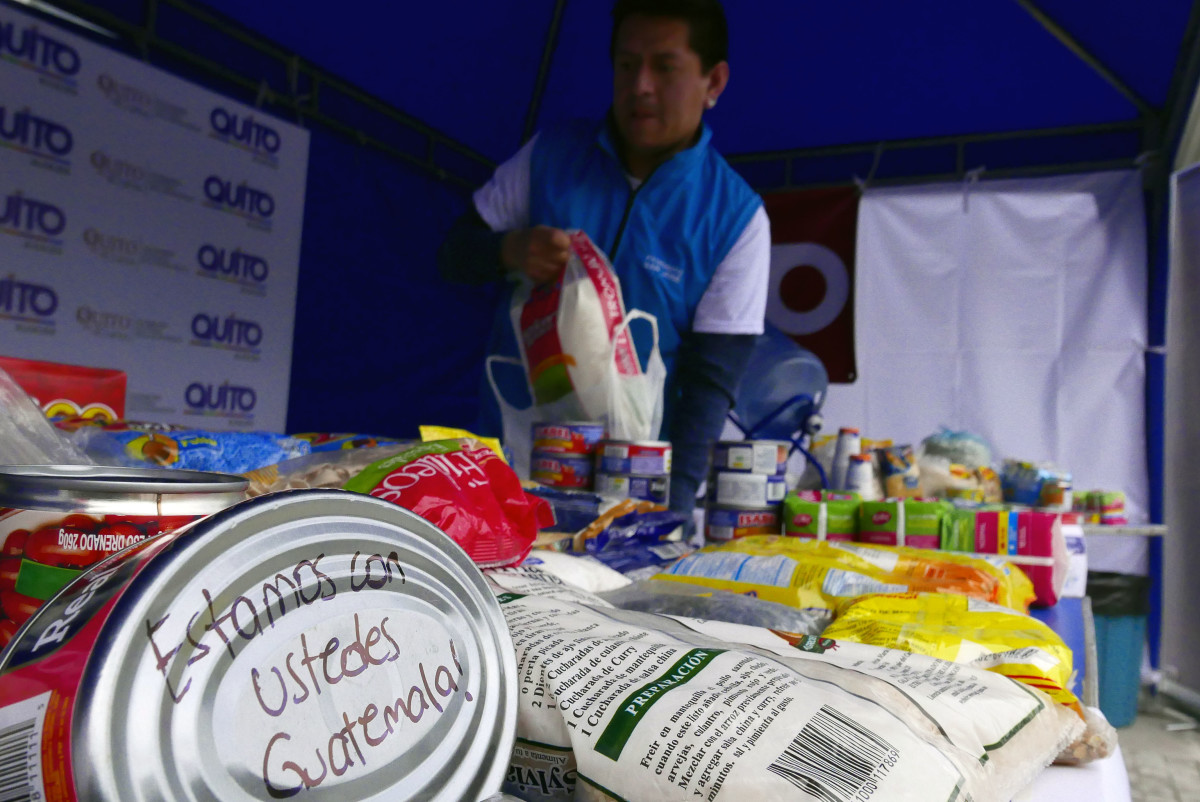 Food cans and packages with solidarity messages are pictured at a collection center of humanitarian aid for the victims of the Fuego volcano in Guatemala, in Quito, on June 5th, 2018.