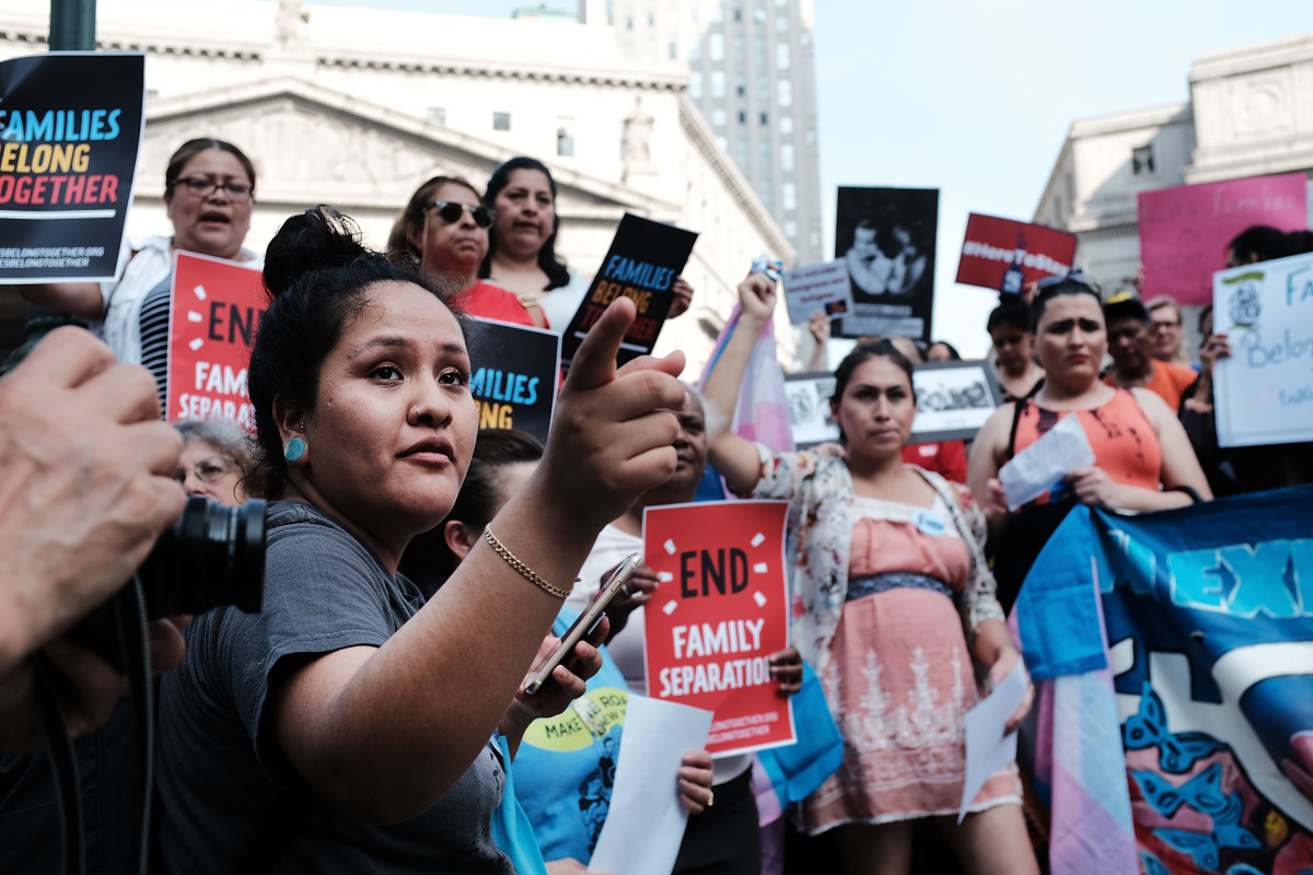 "Hundreds of immigrant rights advocates and others participate in a rally at the Federal Building in lower Manhattan against the Trump administration's ""zero tolerance"" policy on June 1st, 2018."