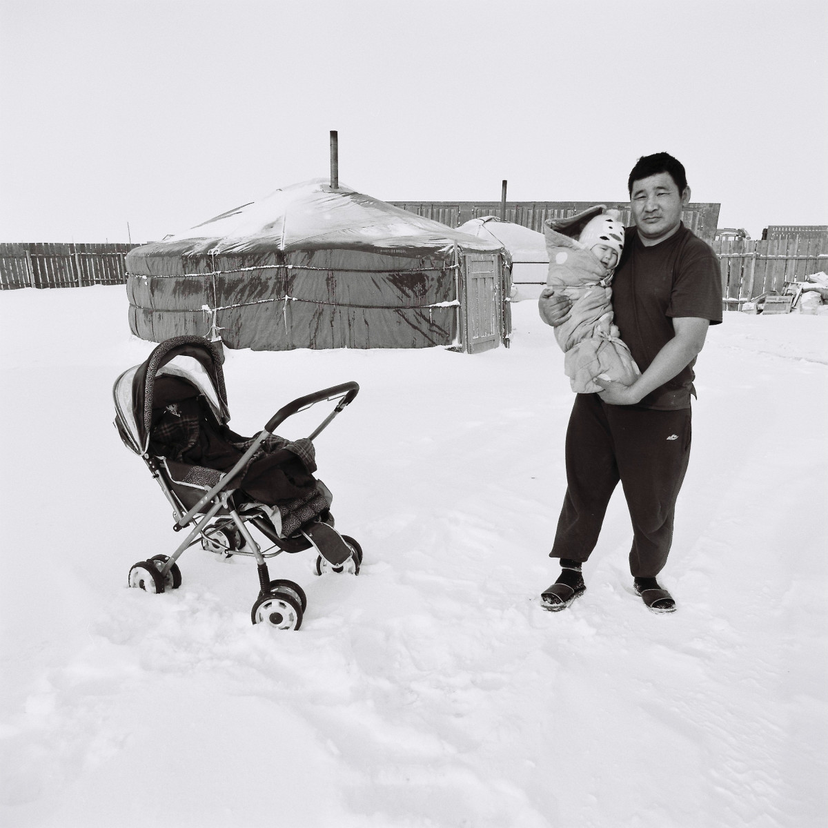 After losing all his animals to the harsh winter conditions in Outer Mongolia, this unemployed herdsman looks after his baby while his wife seeks work in a coal mine.