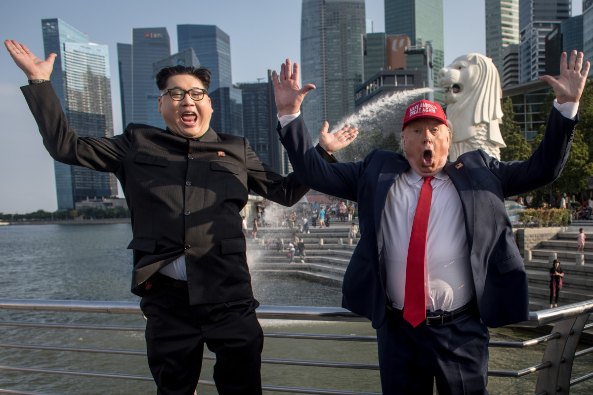Kim Jong-un impersonator Howard X and Donald Trump impersonator Dennis Alan pose for photographers during a visit to the famous Merlion Park on June 8th, 2018 in Singapore. The historic meeting between President Donald Trump and North Korean leader Kim Jong-un has been scheduled in Singapore for June 12th as a small circle of experts have already been involved in talks toward the landmark summit in the city-state.