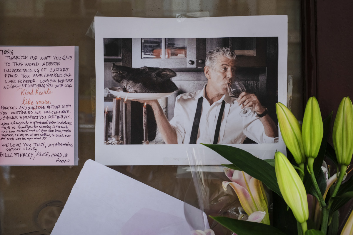 Notes, photographs, and flowers are left in memory of Anthony Bourdain at the closed location of Brasserie Les Halles, where Bourdain used to work as the executive chef, on June 8th, 2018, in New York City.