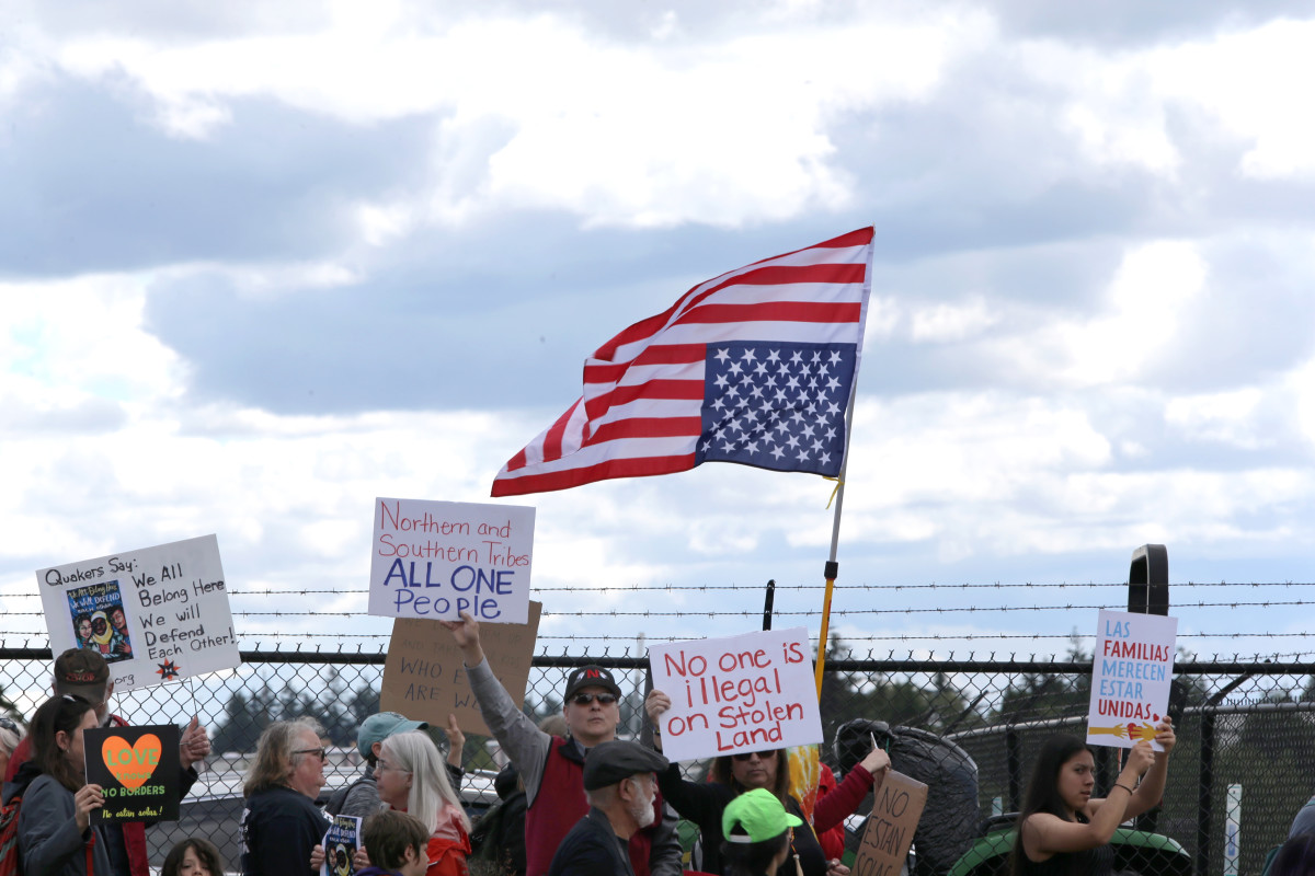 Protesters march outside a federal detention center holding migrant women on June 9th, 2018 in SeaTac, Washington.