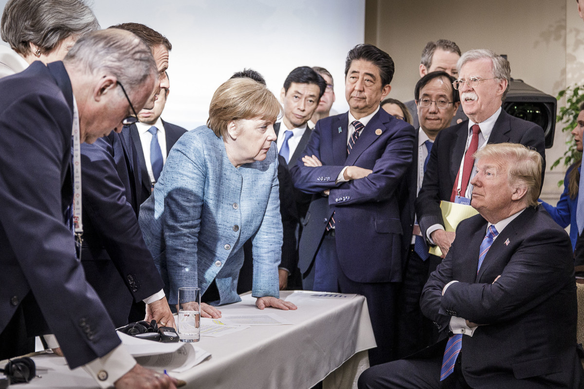 German Chancellor Angela Merkel speaks with President Donald Trump on the second day of the G7 summit on June 9th, 2018, in Charlevoix, Canada.