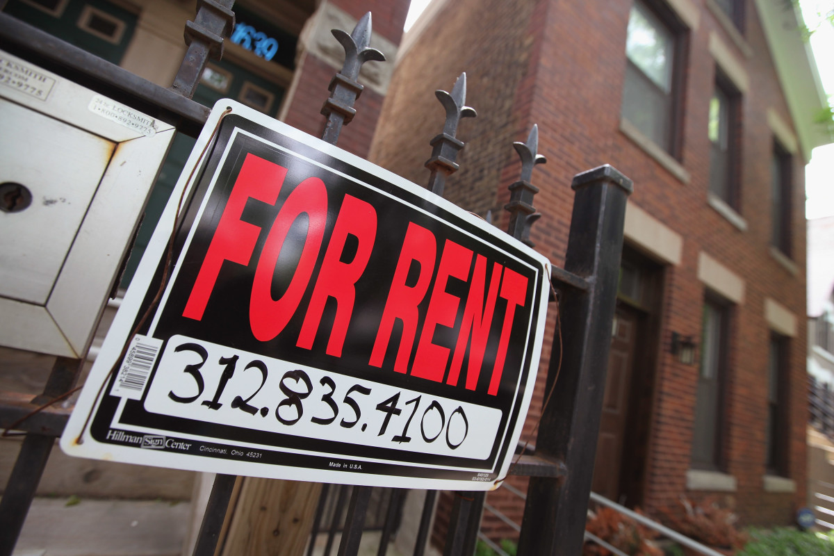 A For Rent sign stands in front of a house on in Chicago, Illinois.