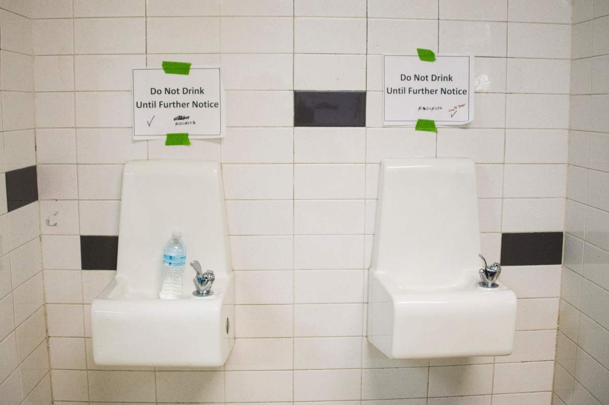 Placards posted above water fountains warn against drinking the water at Flint Northwestern High School in Flint, Michigan, on May 4th, 2016.