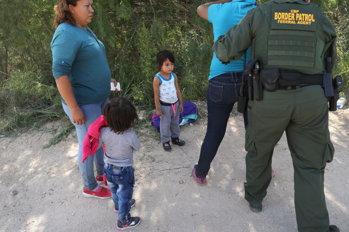 U.S. Border Patrol agents take Central American asylum seekers into custody on June 12th, 2018, near McAllen, Texas.