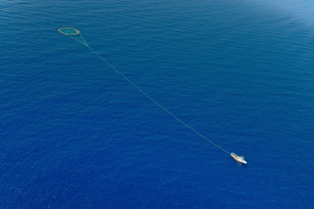 A tuna fishing boat drags a cage of nets on the Mediterranean.