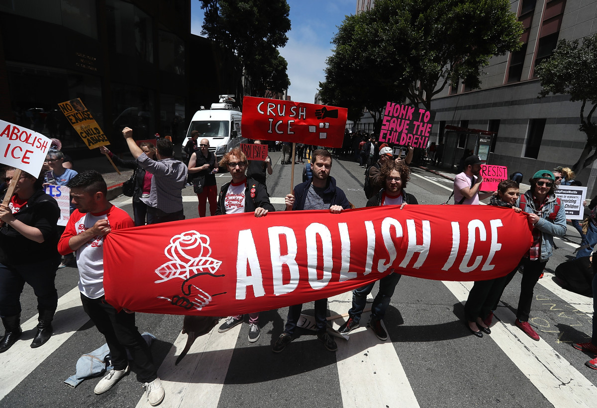 Protesters hold signs as they block Sansome Street during a demonstration outside of the San Francisco office of Immigration and Customs Enforcement on June 19th, 2018, in San Francisco, California. Hundreds of protesters staged a demonstration outside of the ICE offices against the Trump administration's zero tolerance policy to separate immigrant families at the border.