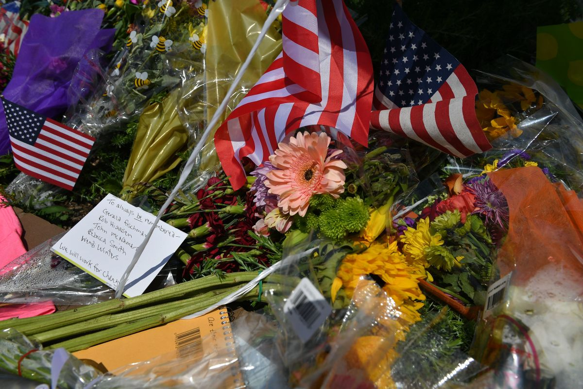 "Flowers, United States flags, and messages adorn a makeshift memorial for five people killed at the Capital Gazette newspaper on June 28th, in Annapolis, Maryland. Jarrod Ramos, who carried out a deadly assault on the newspaper office, had barricaded a back door in an effort to ""kill as many people as he could kill,"" police said Friday."