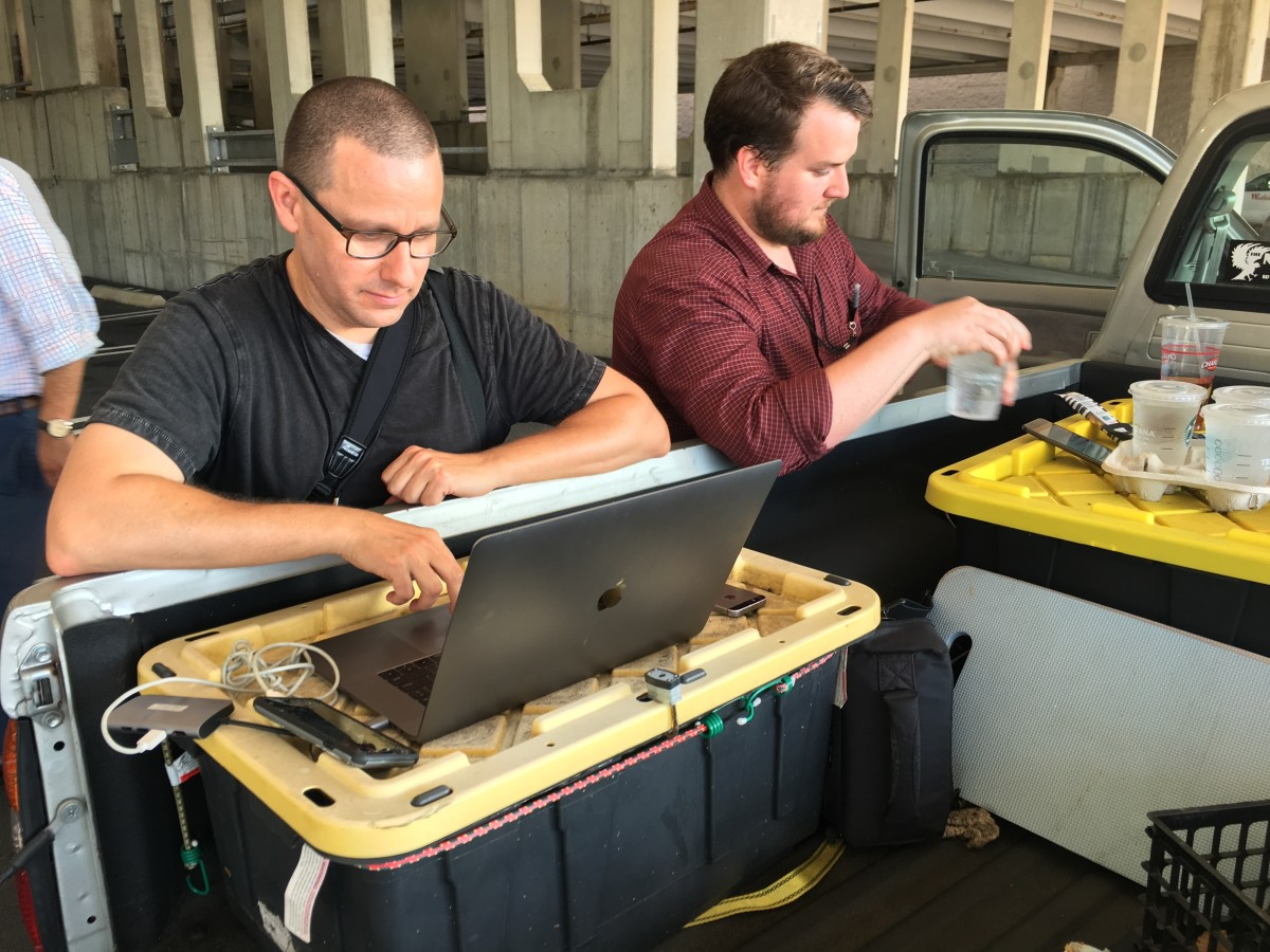 Capital Gazette reporter Chase Cook (R) and photographer Joshua McKerrow (L) work on the next day's newspaper while awaiting news from their colleagues in Annapolis, Maryland, on June 28th, 2018.