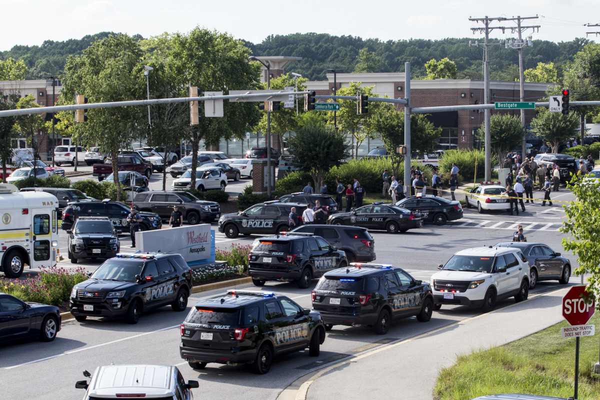 "Police respond to the shooting at the offices of the Capital Gazette in Annapolis, Maryland, on June 28th, 2018. A reporter for the daily, Phil Davis, tweeted that a ""gunman shot through the glass door to the office and opened fire on multiple employees."""