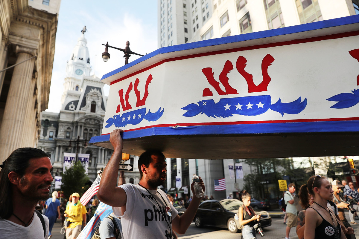 Protesters hold a wooden coffin with an upside down donkey representing the Democratic Party in downtown Philadelphia during the Democratic National Convention on July 26th, 2016, in Philadelphia, Pennsylvania.