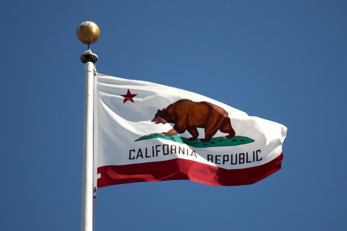 The California state flag flying at San Francisco City Hall.