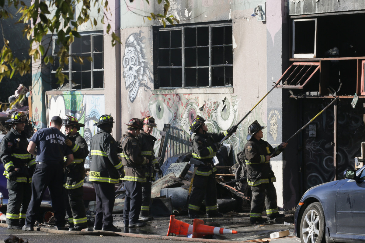 Firefighters work to clear debris following a fire at the Ghost Ship warehouse in Oakland, California, on December 3rd, 2016.
