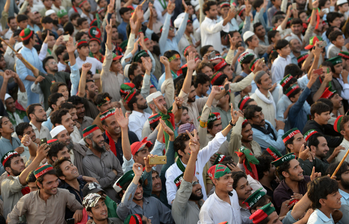 Supporters of Pakistani cricketer-turned-politician and head of the Pakistan Tehreek-i-Insaf (PTI) Imran Khan attend an election campaign rally in Charsadda district, in the Khyber Pakhtunkhwa province, on July 5th, 2018. Pakistan will hold a general election on July 25th, 2018.