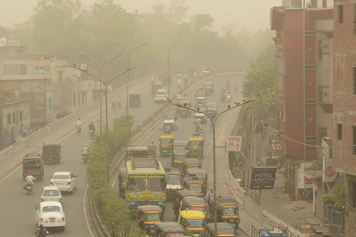 "Commuters makes their way as dust covers the sky in Amritsar on June 15th, 2018. Air pollution soared in New Delhi on June 14th to hazardous levels rarely seen outside winter months as sand blown from deserts enveloped the Indian capital in a once-in-a-decade phenomenon. Doctors warned the visible grit carried by hot summer winds posed serious health risks to the city of 20 million and there was little to do ""but pray for rain."""