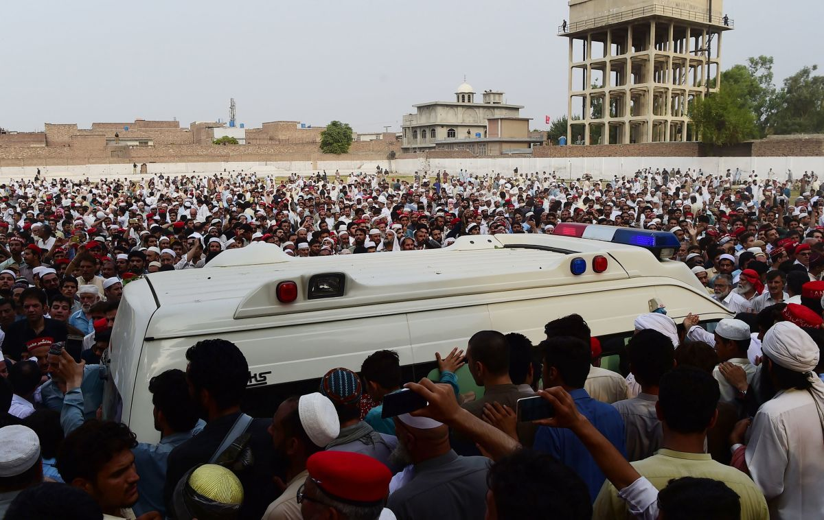 Pakistani supporters of the Awami National Party gather around an ambulance carrying the body of a local leader and ANP candidate, Haroon Bilour, at a funeral in Peshawar on July 11th, 2018.