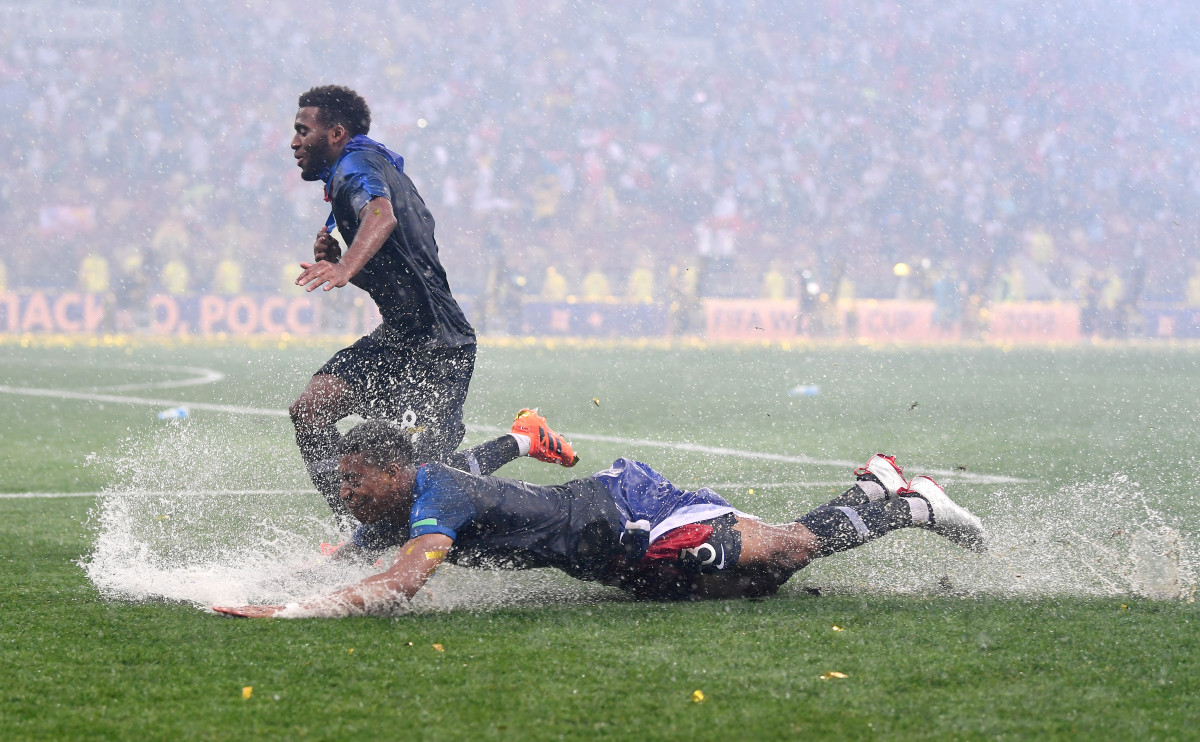 Presnel Kimpembe and Thomas Lemar of France celebrate in the rain after victory in the 2018 FIFA World Cup final between France and Croatia at Luzhniki Stadium on July 15th, 2018, in Moscow, Russia.