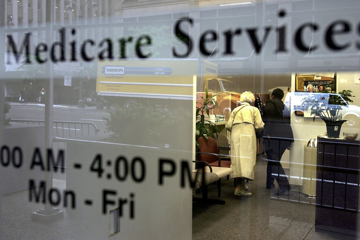 Two people walk inside a Medicare Services office in New York City.
