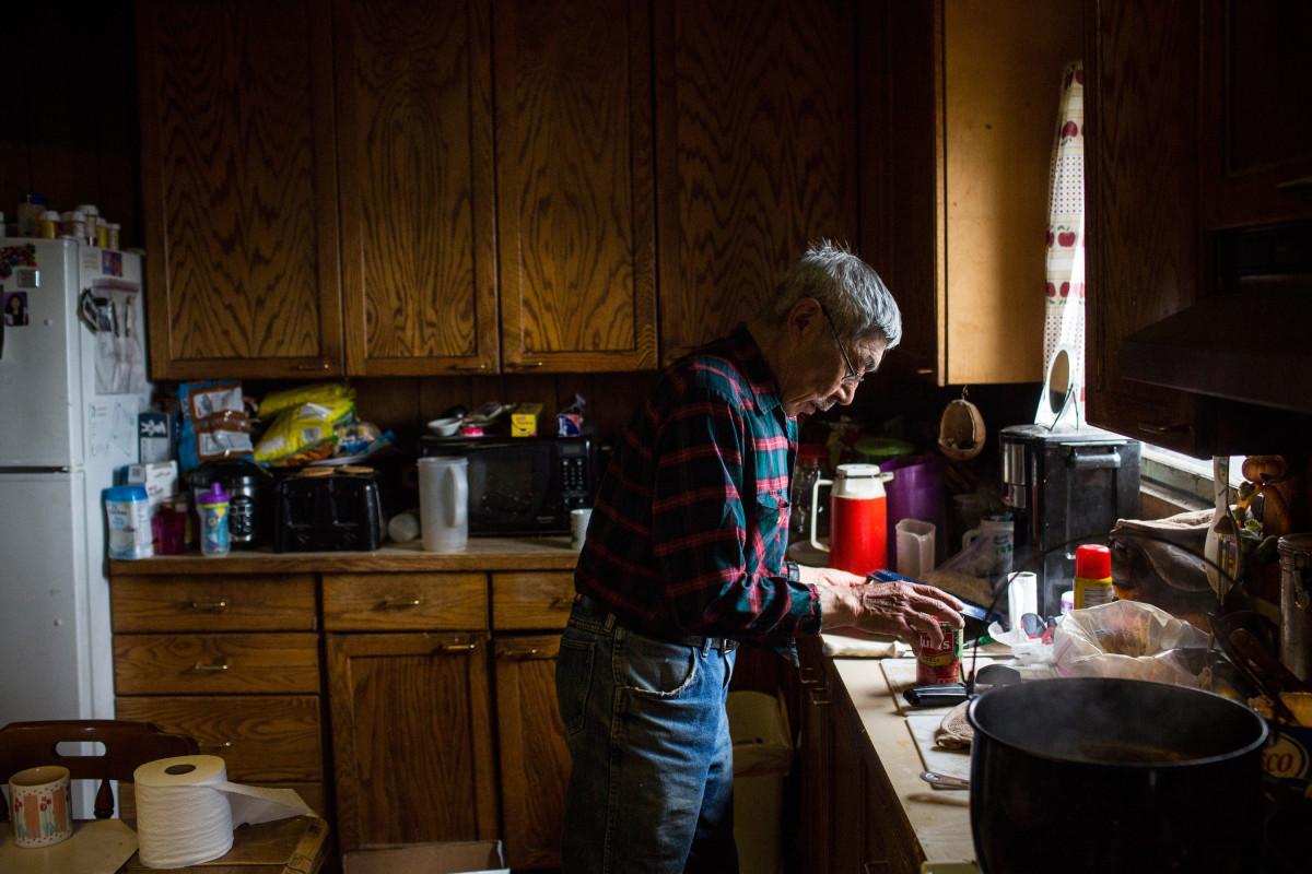 An Alaskan man makes caribou stew.