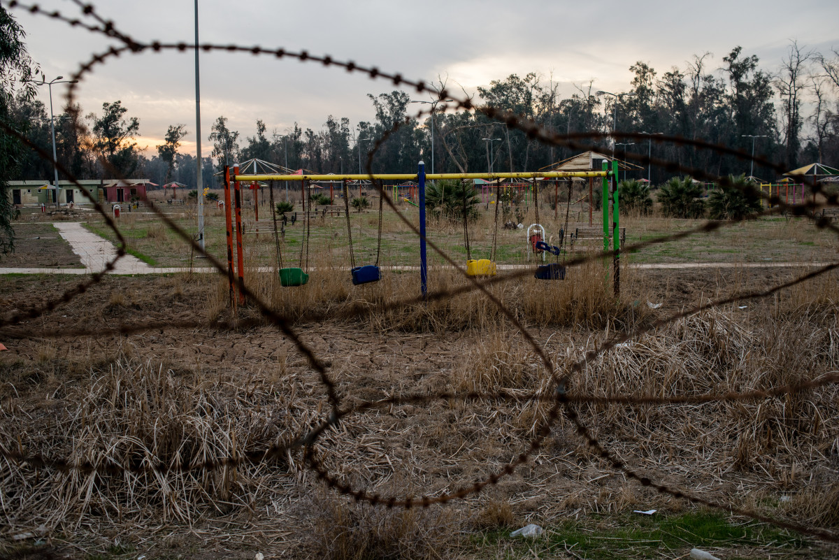 Swings sit empty in a playground city where two disabled boys were found wandering the grounds alone.