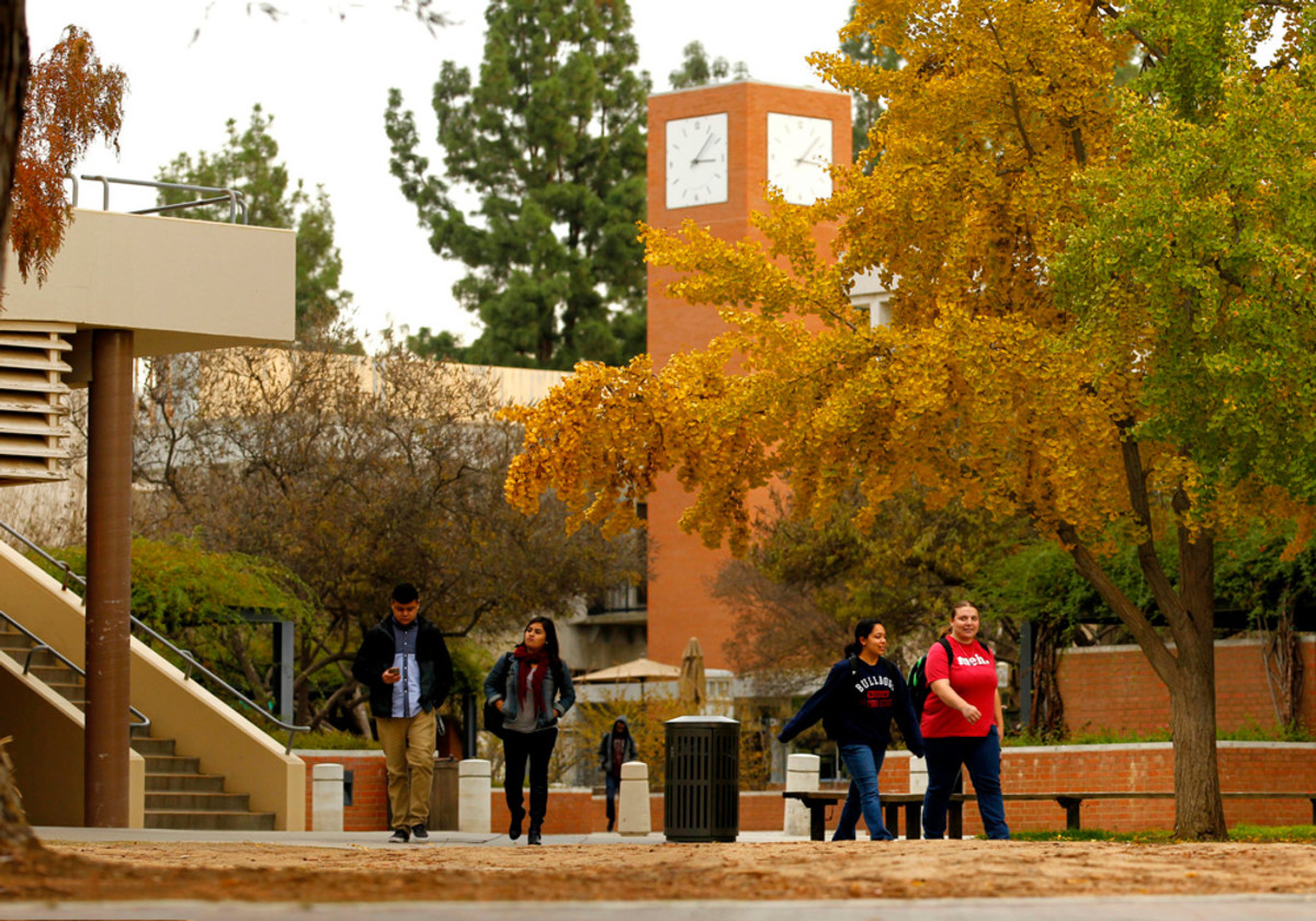 Students walk through campus at California State University–Fresno.