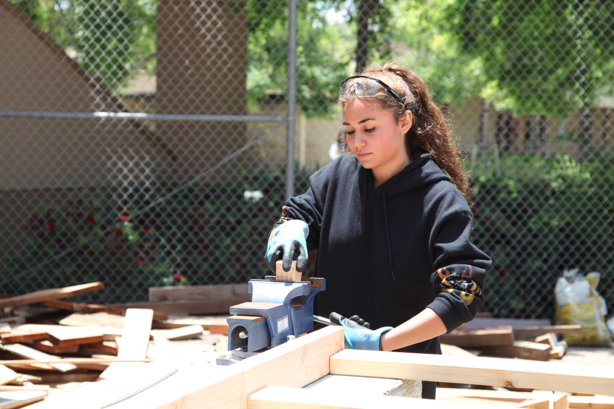Alana Johnson, 18, uses a workbench vise during a construction class at Abraxas Continuation High School, in Poway, California.