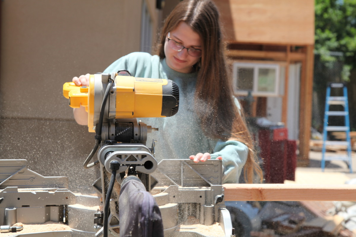 Caitlin Pierce, 17, uses a power saw during a construction class at Abraxas Continuation High School in Poway, California.