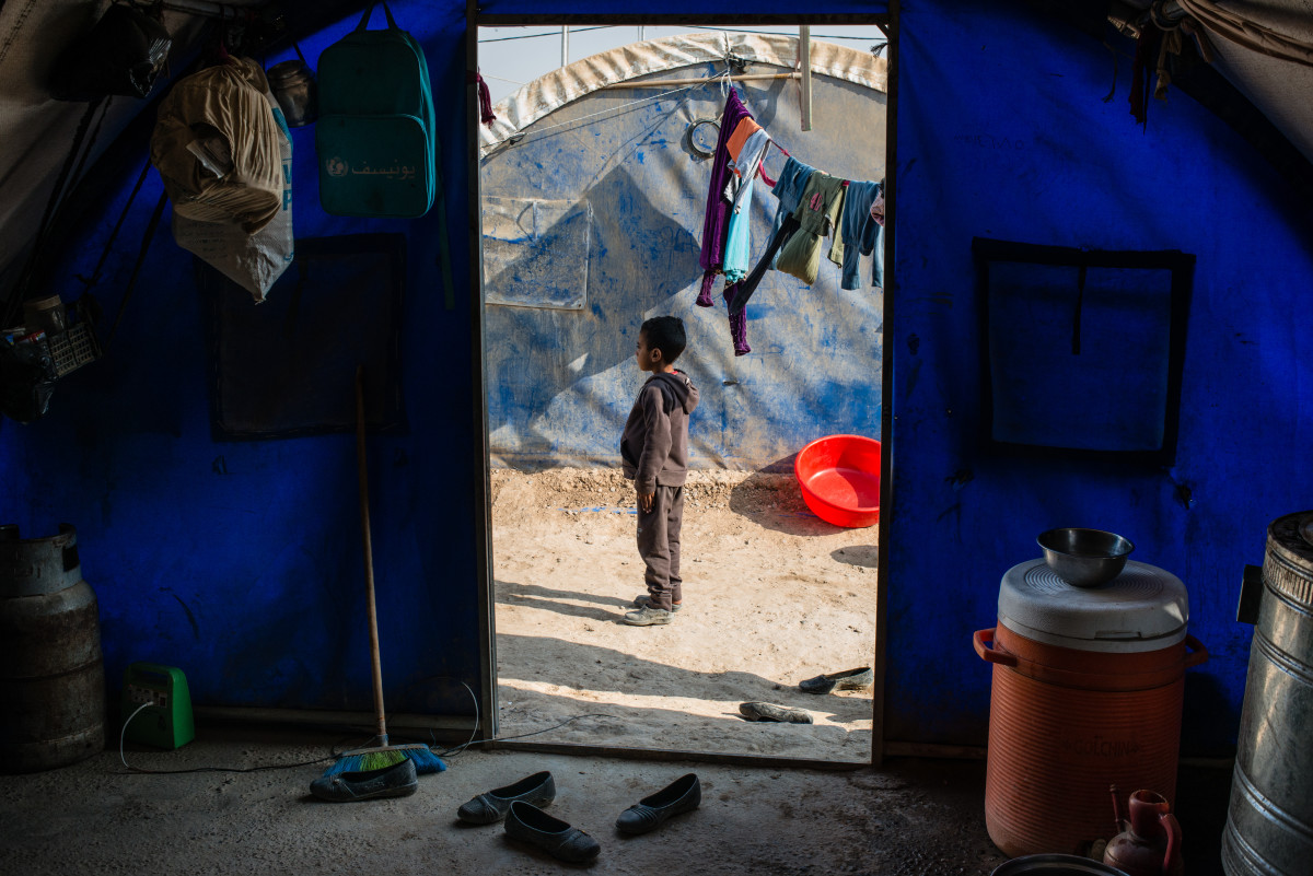 Saqer, a young Sunni boy who suffers from symptoms of post-traumatic stress disorder, lives in Qayyara Jaddah camp with his family, who won't return home for fear of retribution from Yazidi neighbors.
