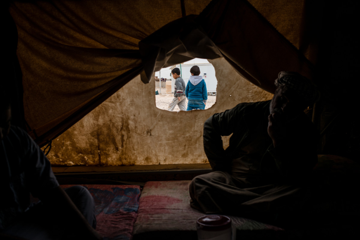 Young boys play outside a tent in Shahama camp, a settlement that holds families with direct or suspected ties to ISIS.